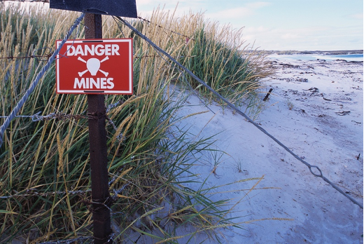 Beach with 'danger mines' warning signage